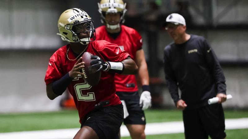 New Orleans Saints quarterback Jameis Winston (2) throws as quarterback Taysom Hill (7) watches...