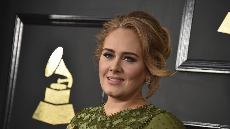 FILE - In this Feb. 12, 2017, file photo, Adele arrives at the 59th annual Grammy Awards at the...