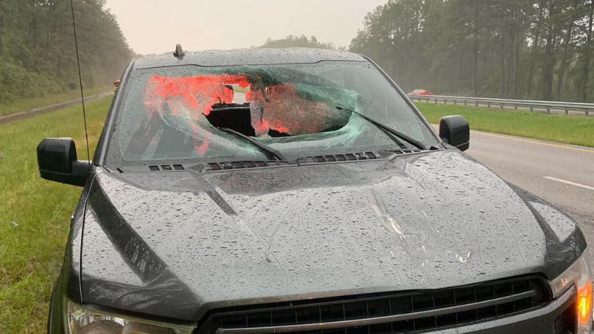 Lightning struck a portion of Interstate 10, causing a chunk of the road to fly through the...