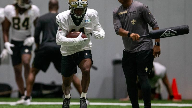 New Orleans Saints wide receiver Deonte Harris (11) runs a drill with senior offensive...