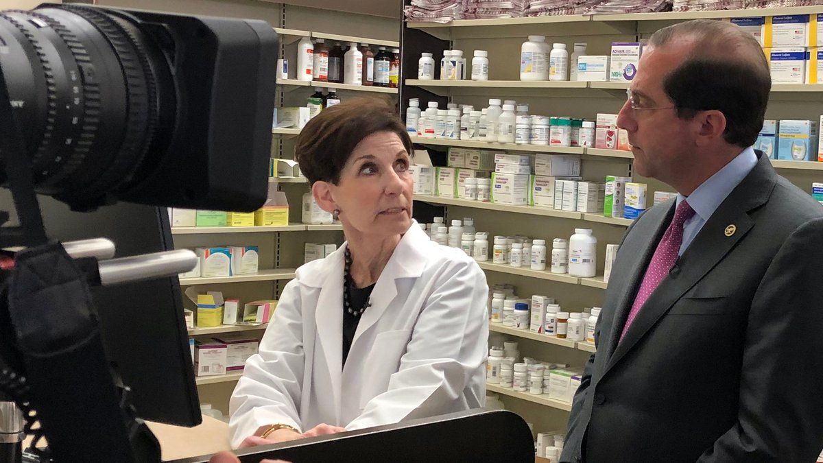 Health and Human Services Secretary Alex Azar visits with a Metairie pharmacist during a visit...