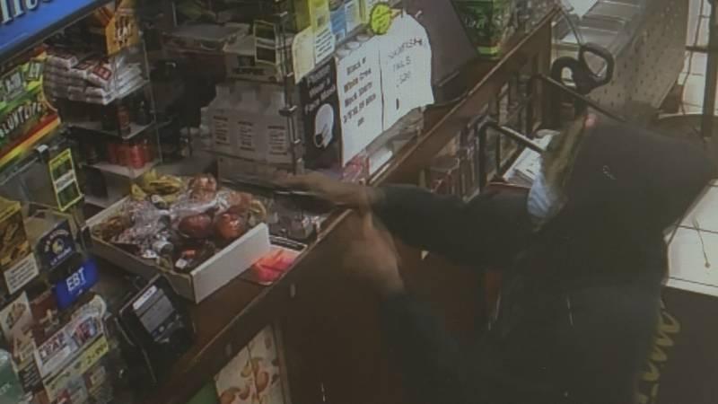 Surveillance video at a New Orleans gas station where a gunman demands cash.