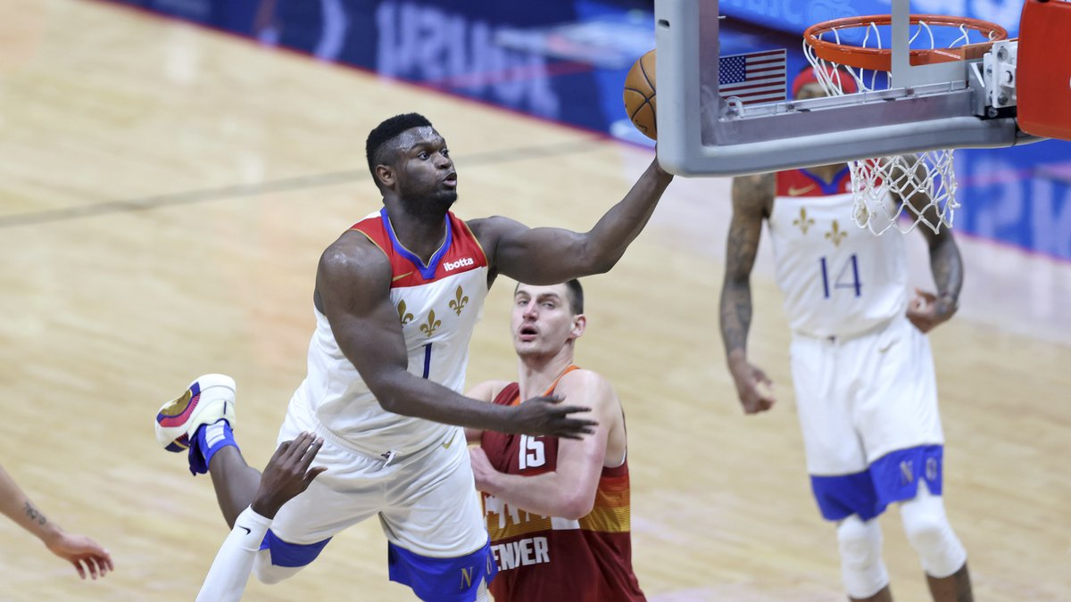 New Orleans Pelicans forward Zion Williamson (1) goes up for a basket in the second half of an...