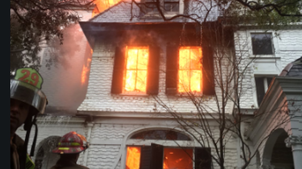 Firefighters work to put out a 7-alarm fire at a historical home in the Garden District.
