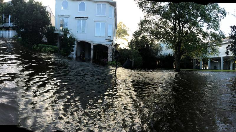 Residents along the lake in Mandeville after storm surge caused flooding in their neighborhood.