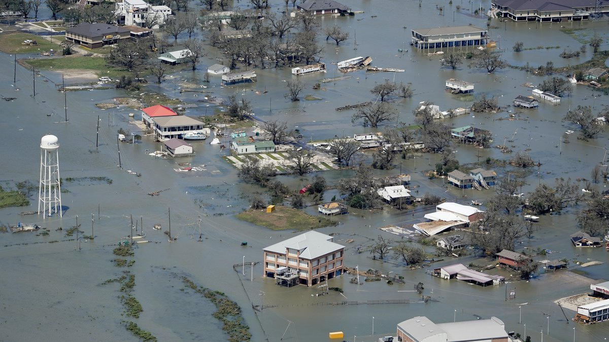 FILE - In this Aug. 27, 2020, file photo, buildings and homes are flooded in the aftermath of...