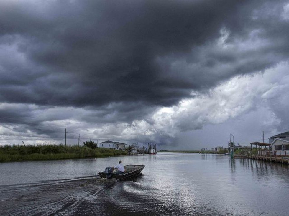 A boat makes its way down the bayou in the Grand Bayou community in Plaquemines Parish (FOX 8...