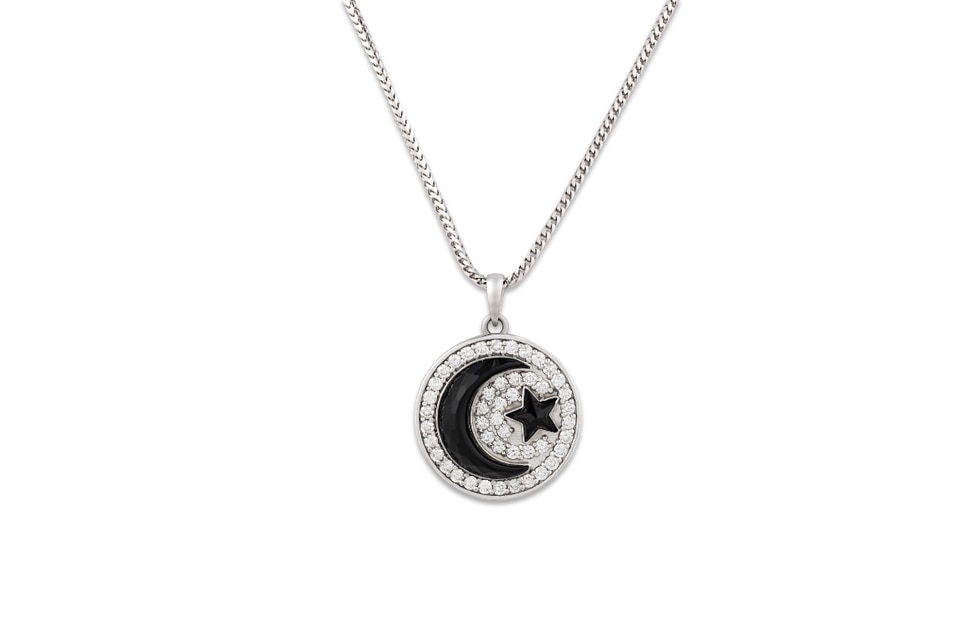 Prince's Onyx Crescent Moon Pendant was also custom-made for Prince. It takes the shape of a...