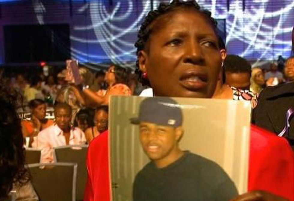 """Cutine Pittman holds a photo of her late grandson, Jaquon, at the """"Guns Down"""" anti-violence..."""