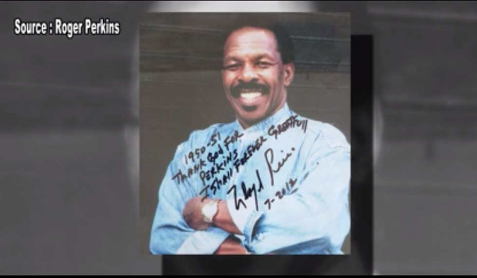 A photo of Lloyd Price hanging in Perkins' Bars in Kenner with a handwritten message from Price.