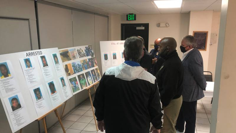 Terrebonne Parish law enforcement leaders look at boards at the sheriff's office of arrests...