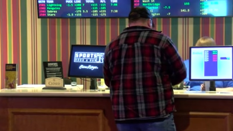 A man places a bet at the Beau Rivage Sports Book on Wednesday as Coast casinos gear up for...