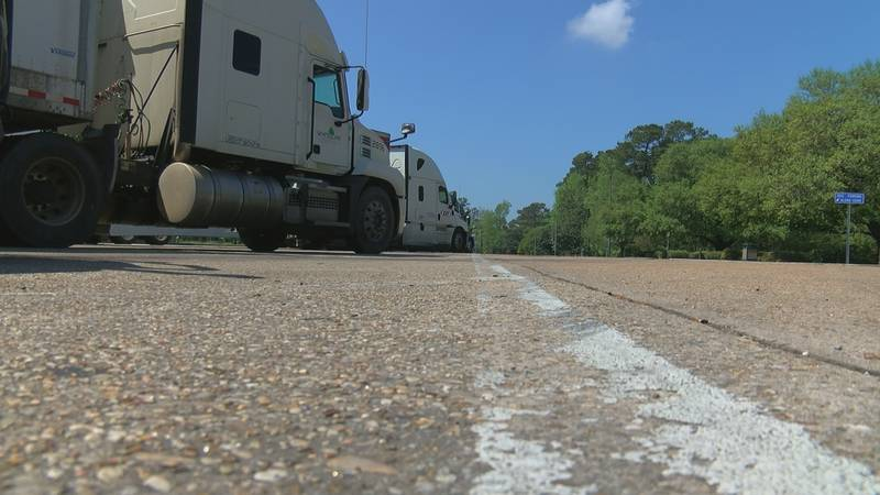 Several truck drivers park at a Louisiana rest stop as demand grows.