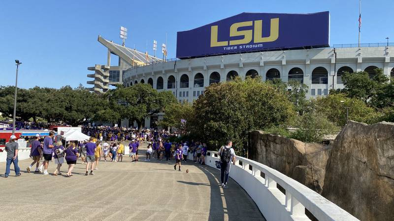 Fans tailgate outside of Tiger Stadium on LSU's campus in Baton Rouge, La. for the Tigers first...