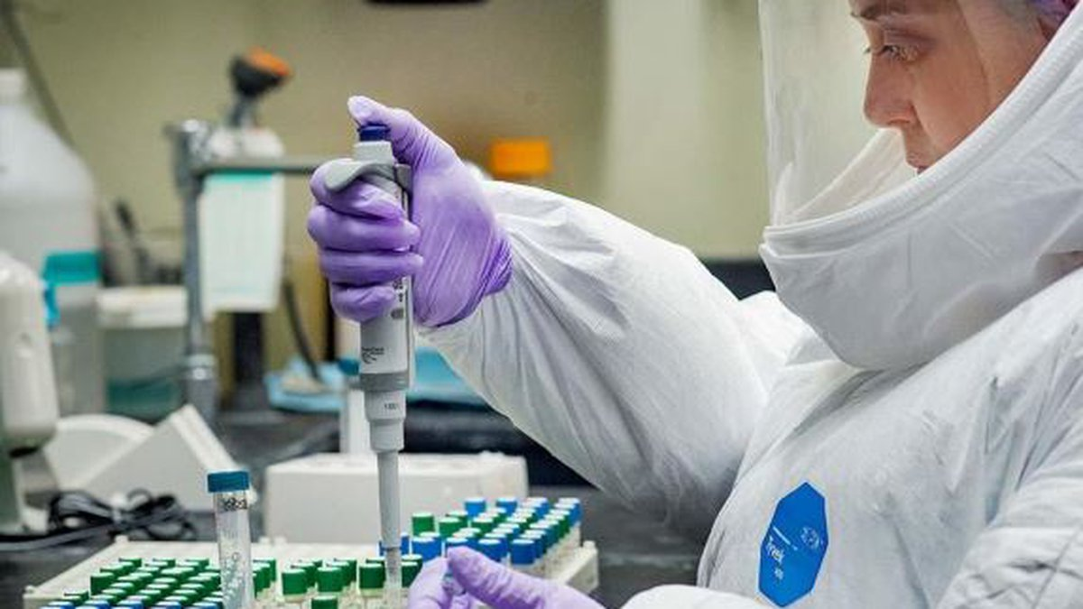 A COVID-19 researcher in the biosafety level 3 laboratory at the Tulane National Primate...