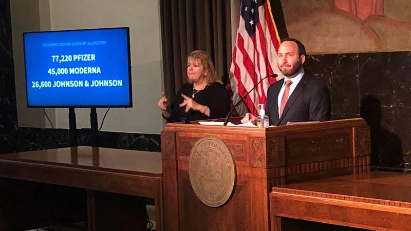 Dr. Joseph Kanter (right), of the Louisiana Department of Health, and Gov. John Bel Edwards...