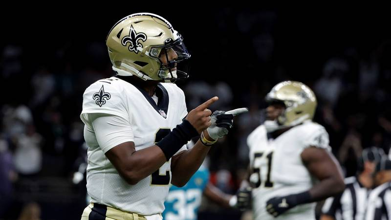 New Orleans Saints quarterback Jameis Winston (2) reacts after throwing a touchdown pass in the...