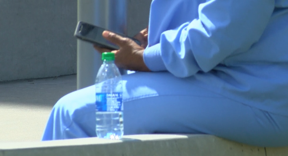 Healthcare worker sits outside a medical facility