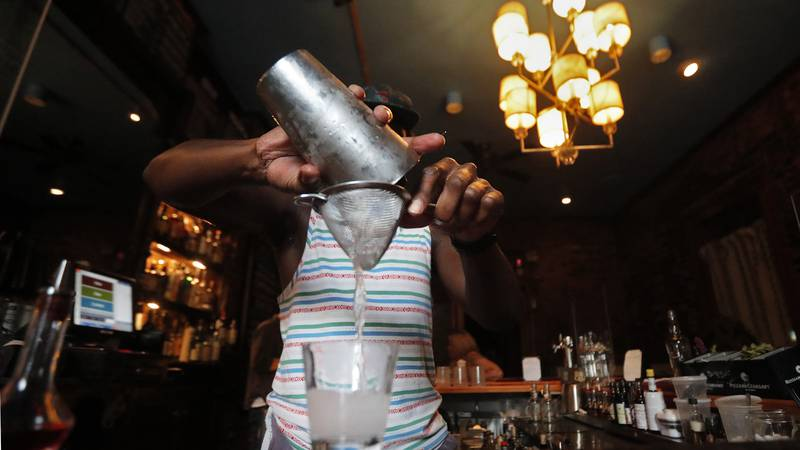 In this Thursday, July 9, 2020 file photo, a bartender makes a cocktail in New Orleans. Loyola...