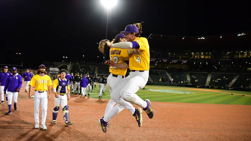Jordan Thompson (13) and Cade Doughty (4) celebrate after taking down Oregon in the Eugene...