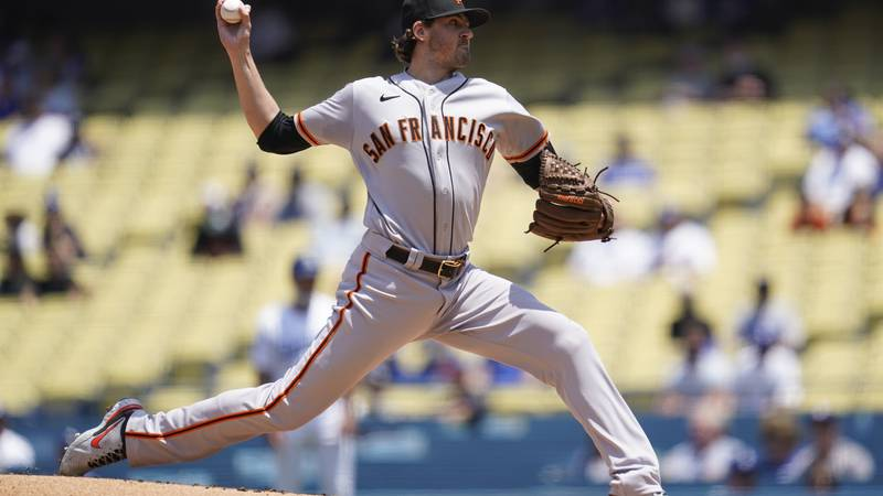 San Francisco Giants starting pitcher Kevin Gausman (34) throws during the first inning of a...