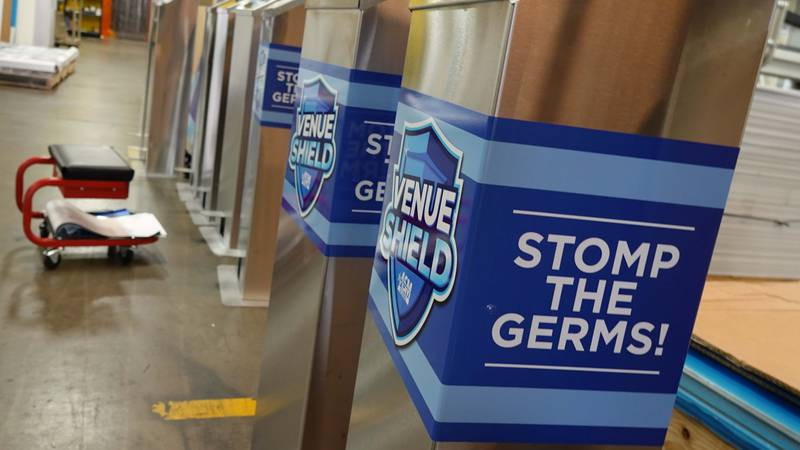 PurePedal sanitizer dispensers, lined up at company offices in Elmwood, LA