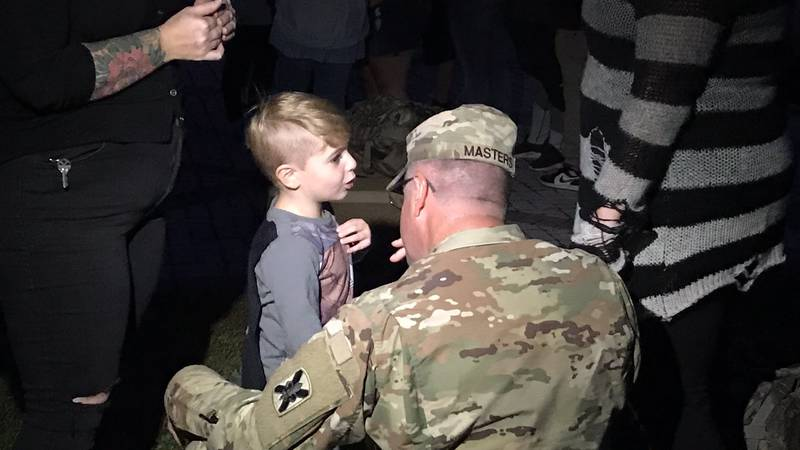 A Louisiana National Guardman says goodbye to his family as he and the troop get ready for an...