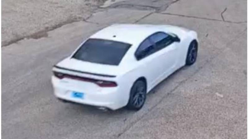 The pictured wanted vehicle is described as a white Dodge Charger with a blue dealership...