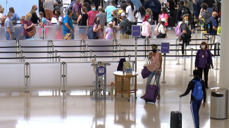 Thousands of travelers head to flights at Armstrong Airport ahead of the 4th of July holiday.