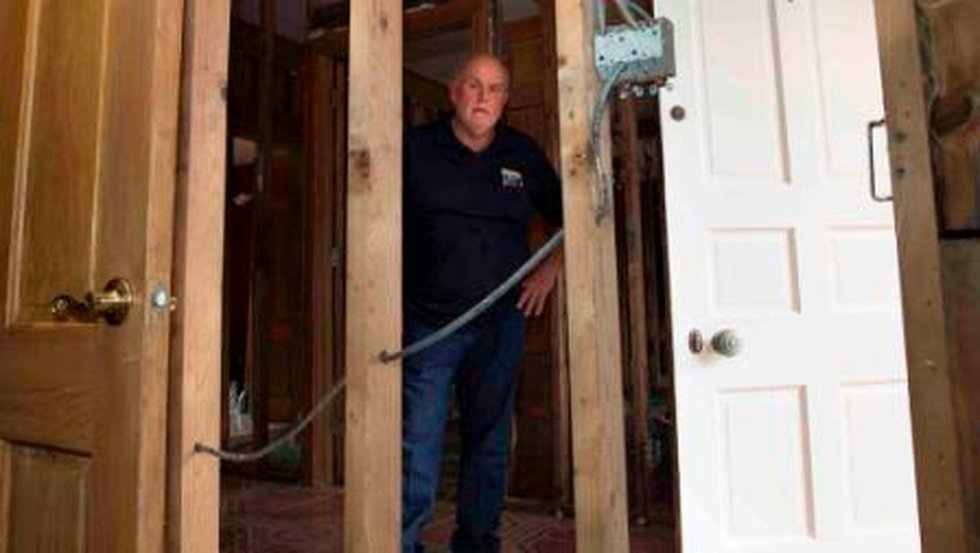 Harold Gourgues stands in the foyer of his home damaged by Hurricane Isaac (John Snell)