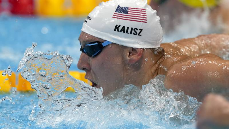 Chase Kalisz, of the United States, swims in the final of the men's 400-meter individual medley...