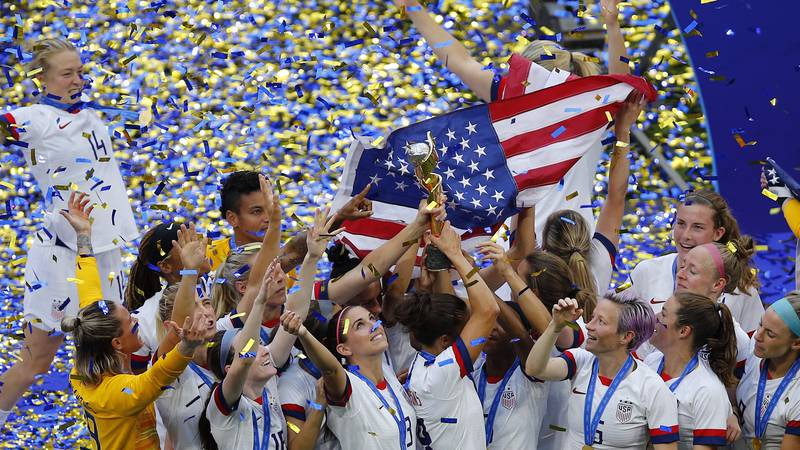 The US team lifts the trophy after the team won the Women's World Cup final soccer match...