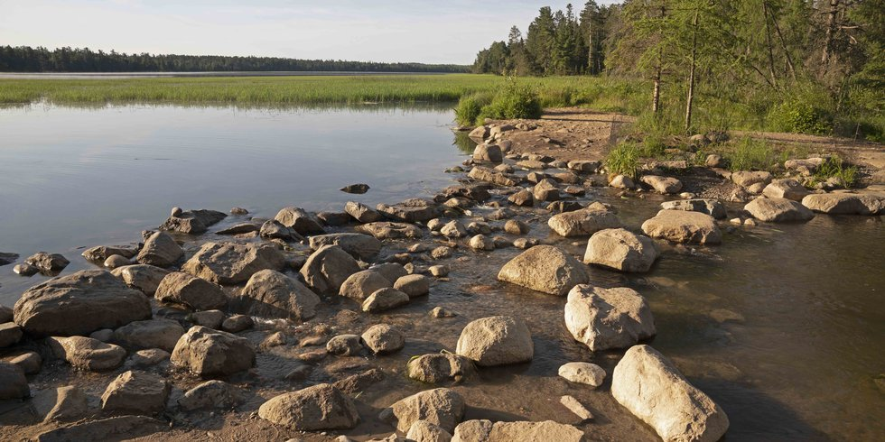 Rocks separate Lake Itasca on the left from the Mississippi River on the right