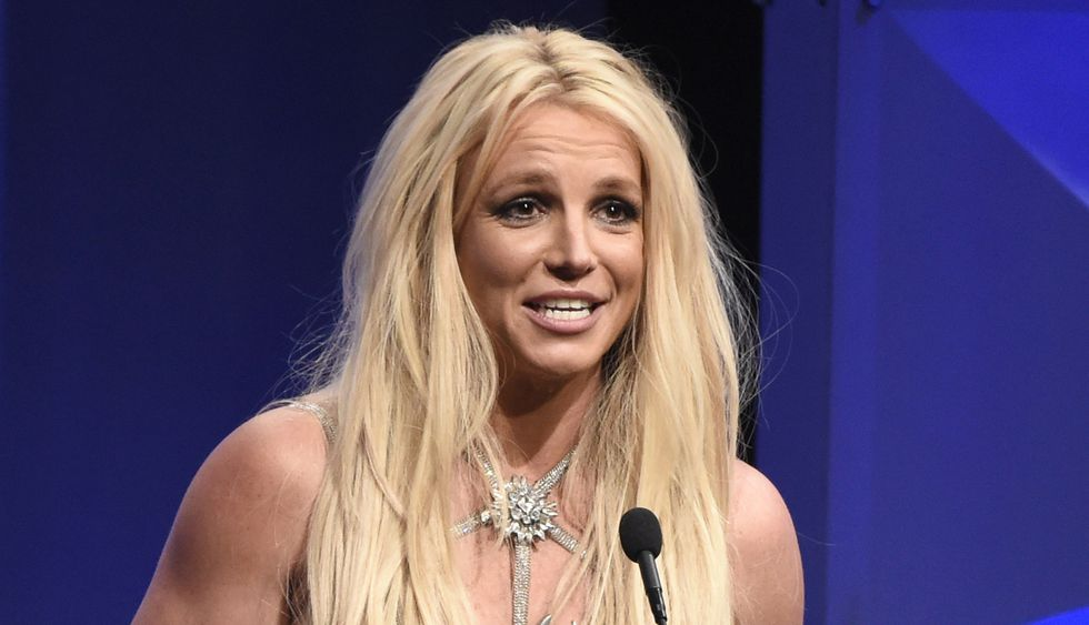 FILE - In this Thursday, April 12, 2018, file photo, Britney Spears accepts the Vanguard award...