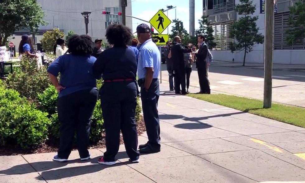 Linda McMillian, left center, looks on as her attorney, Danatus King, speaks to FOX 8's Lee...