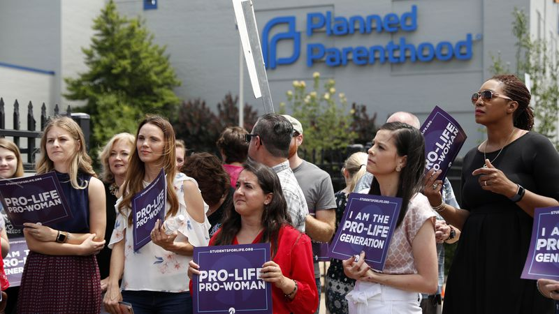 In this June 4, 2019, file photo, anti-abortion advocates gather outside the Planned Parenthood...