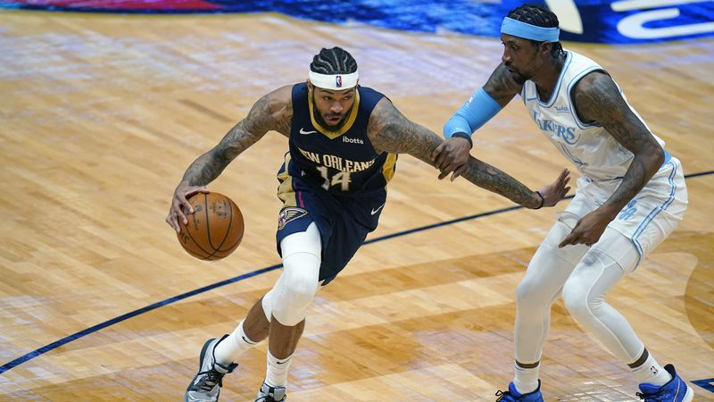 New Orleans Pelicans forward Brandon Ingram (14) drives to the basket against Los Angeles...