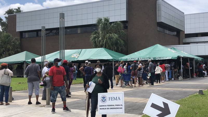 People line outside Joe Brown Park in New Orleans East seeking federal assistance for past-due...
