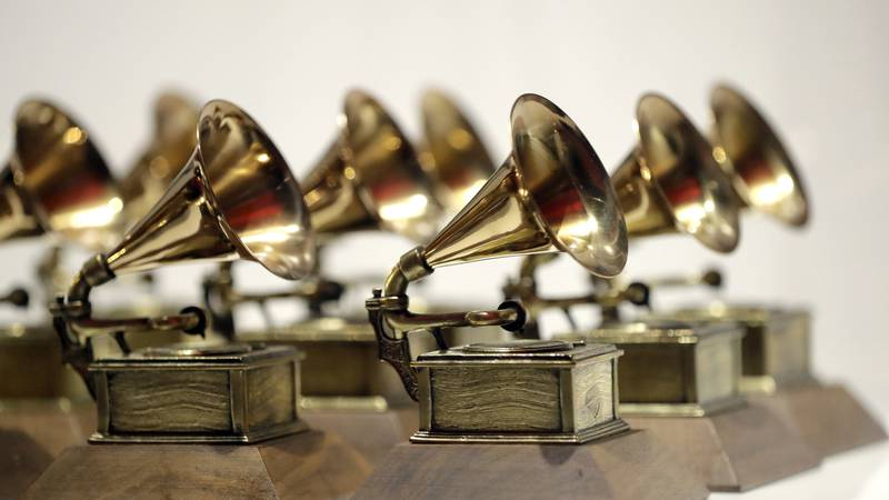 In this Oct. 10, 2017, file photo, various Grammy Awards are displayed at the Grammy Museum...