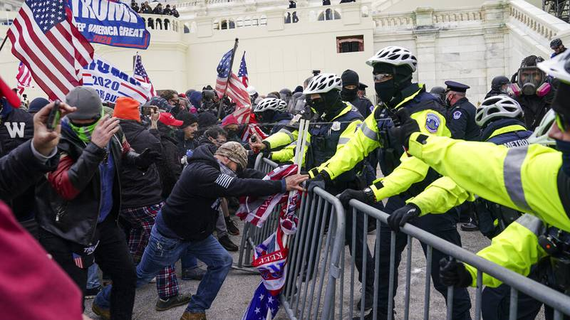 Trump supporters try to break through a police barrier, Wednesday, Jan. 6, 2021, at the Capitol...