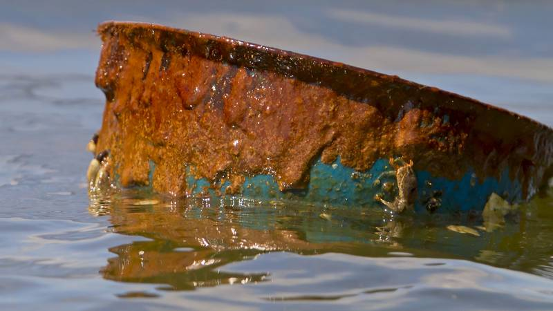 A hard hat coated in crude oil was pulled from Barataria Bay on May 22, 2010