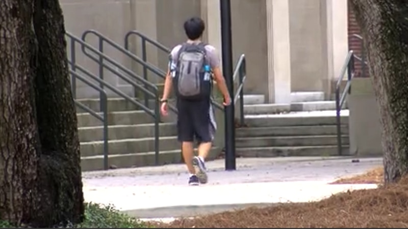 Universities say they will adopt hybrid model, which will eliminate deportation risk for...