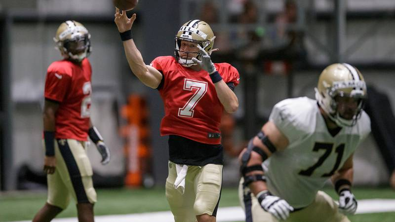New Orleans Saints quarterback Taysom Hill (7) runs a play during training camp at the inside...