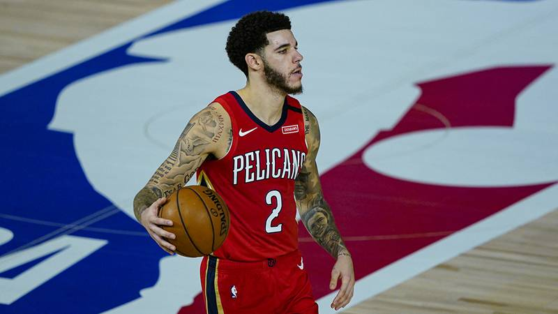 New Orleans Pelicans' Lonzo Ball (2) brings the ball up court against the Memphis Grizzlies...