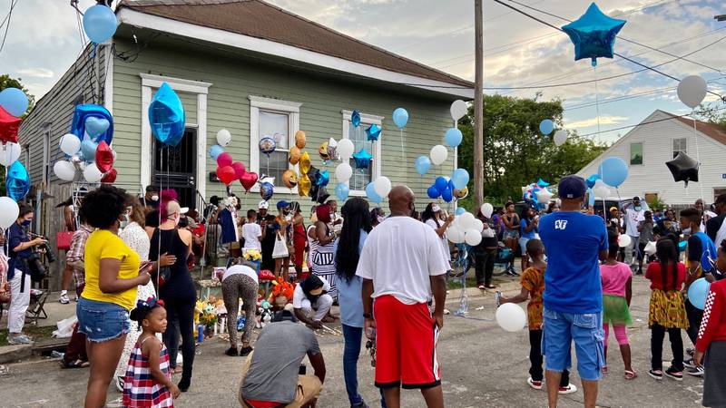 Family, neighbors and community members call for action following death of nine-year-old.