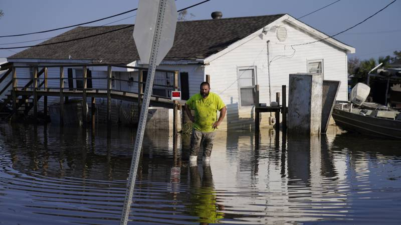 Nathan Fabre checks on his home and boat destroyed by Hurricane Ida, Sunday, Sept. 5, 2021, in...