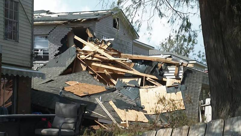 Home damage from Hurricane Ida is seen in Kenner, La.