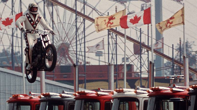 FILE - In this Aug. 20, 1974, file photo Daredevil motorcyclist Evel Knievel sails over 7 Mack...