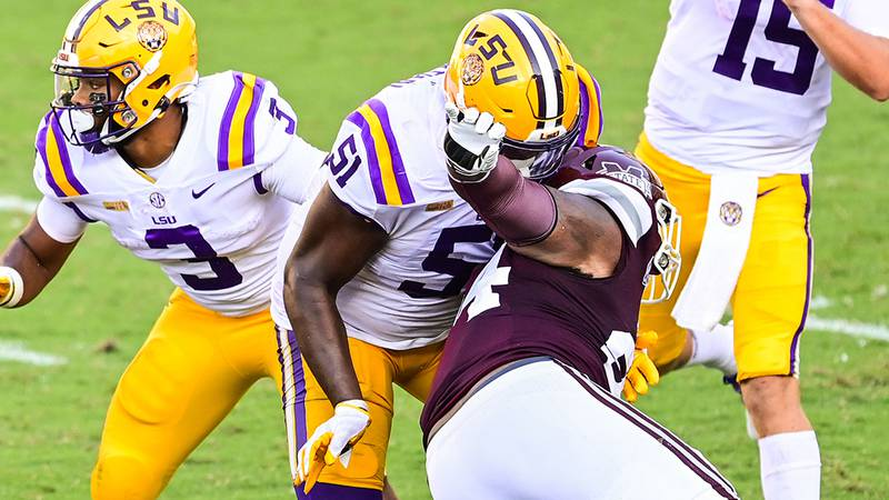 LSU offensive tackle Dare Rosenthal (51) blocks a rusher against Mississippi St. Bulldogs...