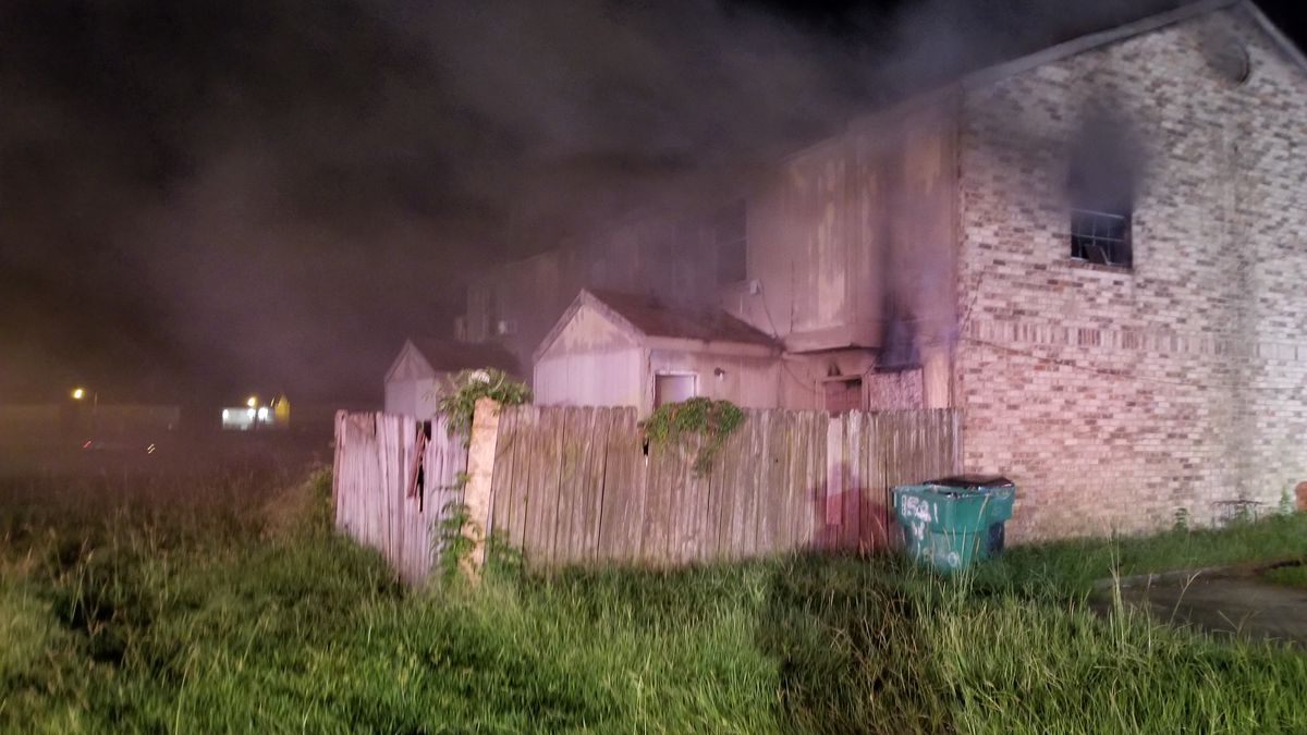 Smoke pours out of windows in the apartment complex on West Chelsea Road in Harvey, La. One...